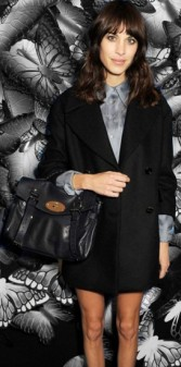 Alexa Chung is dressed demurely here in a long black blazer to match her fashion  handbag Mulberry Alexa 92c31063fc368